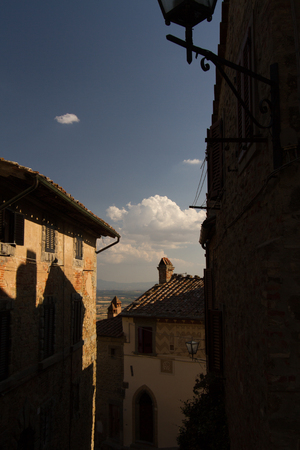 This village of Etruscan origin is named Cortona and is located in Tuscany, Italy.