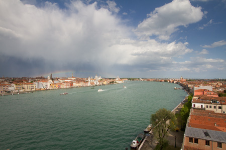Giudecca canal from the Hilton Molino Stucky swimming pool terrace, with a beautiful rainbow born after a thunderstorm.