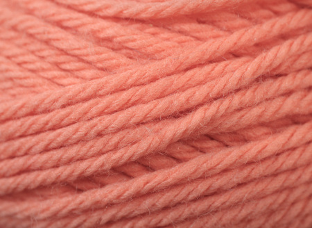 A super close up image of tangerine yarn