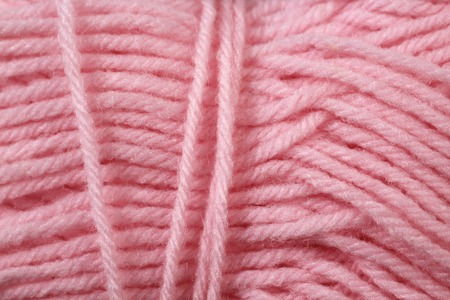 A super close up image of pink yarn