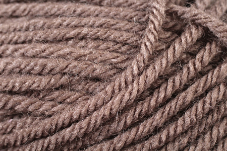 A super close up image of chocolate brown yarn