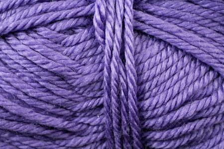 A super close up image of royal purple yarn