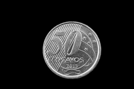 A super macro image of a 50 centavo Brazilian coin isolated on a black background