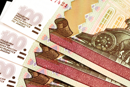 A close up image of a spread of Russian hundred ruble bank notes