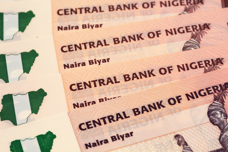 A close up image of Nigerian bank notes and coins