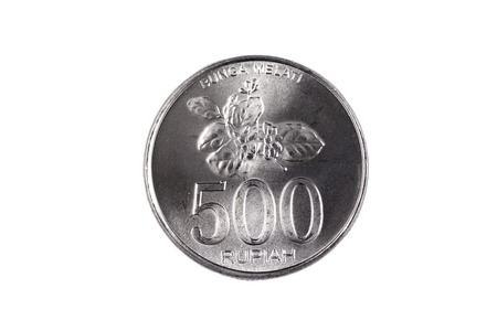 An extreme close up of an Indonesian 500 rupiah coin on a solid white background