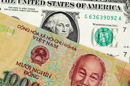 A Vietnamese Ten Thousand Dong Note With An American One Dollar Bill