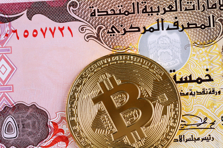 A United Arab Emirates five dirham note with a golden bitcoin