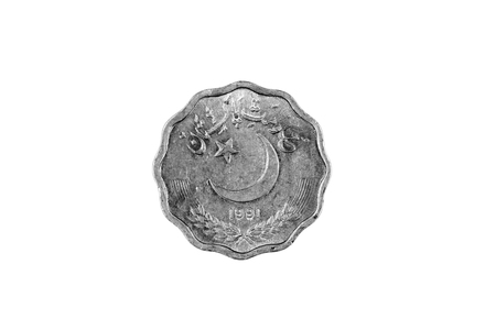 A super macro image of an old 10 Pakistani rupee coin isolated on a white background