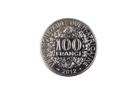 A close up image of a silver 100 West African franc coin isolated on a white background