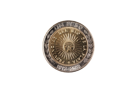 A close up image of a bimettalic Argentinian one peso coin isolated on a white background