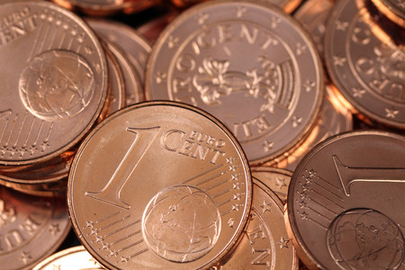 A pile of shiny new one Euro cent coins shot in extreme macro