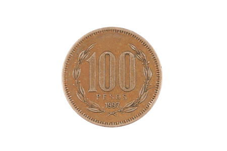 A macro image of an old Chilean one hundred peso coin isolated on a white background