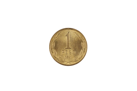 A macro image of a gold one Chilean peso coin isolated on a white background