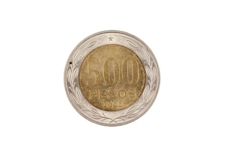 A macro image of an old Chilean five hundred peso coin isolated on a white background Banco de Imagens - 117556345