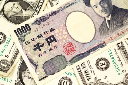 A one thousand Japanese yen bank note close up in macro with American one dollar bills 免版税图像