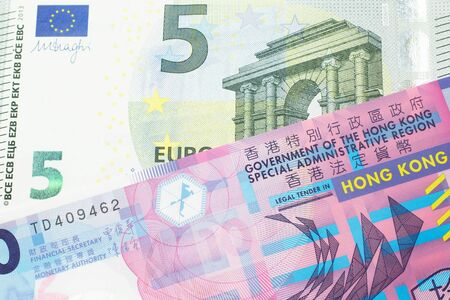 A colorful ten dollar bill from Hong Kong shot in macro with a blue and green, European Union, five euro bill Standard-Bild