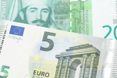 A twenty Serbian dinar bank note, close up in macro with a five euro German bank note