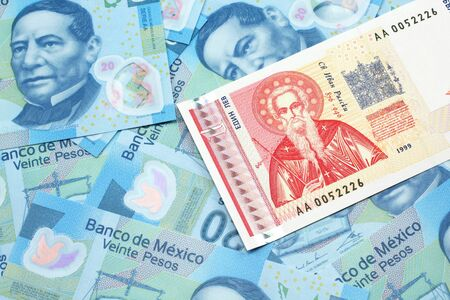 A macro image of a red and white Bulgarian lev bank note with Mexican twenty peso bank notes Stock Photo