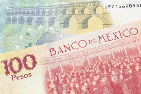 A one hundred Mexican peso bill, shot in macro with a five euro bank note from the European Union