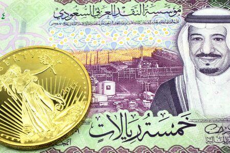 A macro image of a green one Saudi riyal bank note with a gold bar.  Shot close up. Stock Photo