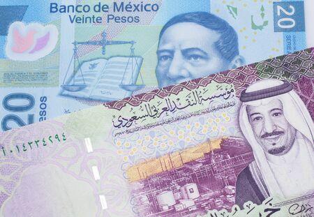 A twenty Mexican peso bill, shot in macro with a five Saudi riyal bank note from Saudi Arabia