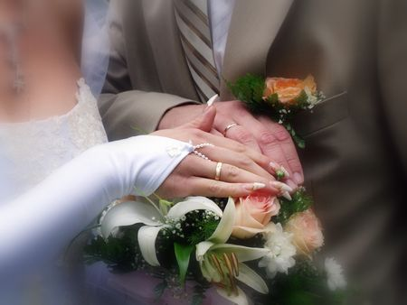 Wedding rings and bouquet with roses and lilies     photo