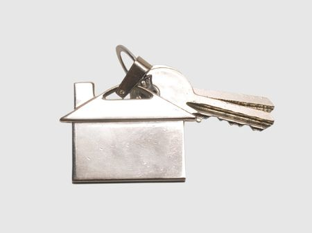 Keys to the house with a metal thumb image building photo