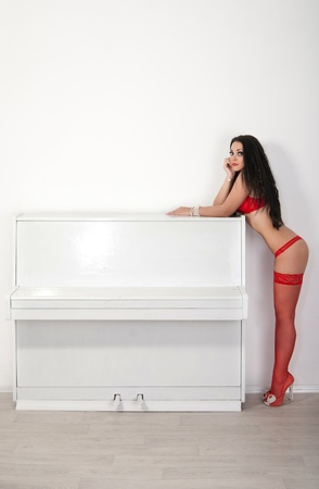 The girl in red stockings near the white piano photo