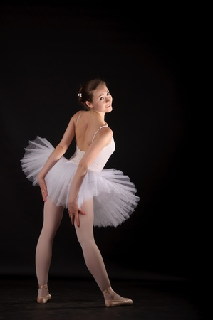 Ballerina in a white skirt and a bathing suit, pointe, dance poses Stock Photo - 9959371