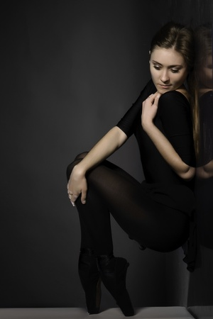 ballerina tights: Pensive ballerina in black tights and pointe, in the artistic process