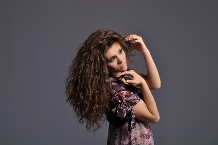 beautiful sexy girl with wealth of wavy hair and professional make-up photo