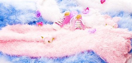 coatings: in multi-colored furry coatings are flowers and Baby Shoes Stock Photo