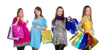 four pregnant beautiful women friends on shopping holding colourful parcels