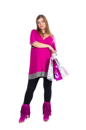 beautiful pregnant woman with packing bags, going shopping photo