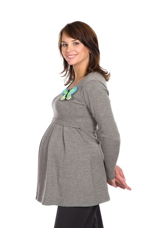 nice pregnant smiling woman wearing grey dress with butterfly brooch