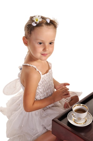 nice little princess in beautiful white dress ans hazel eyes  having tea with zephyr  isolated on white background Stock Photo - 11885065