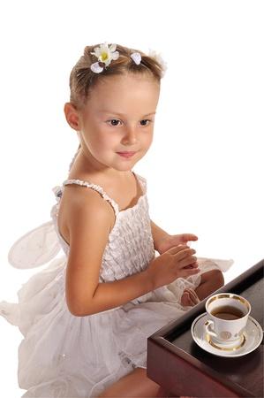 hazel eyes: nice little princess in beautiful white dress ans hazel eyes  having tea with zephyr  isolated on white background