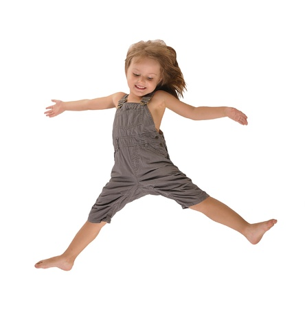 disheveled: active pretty little girl with disheveled hair in rompers jumping happily isolated on white background
