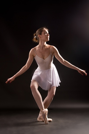 ballerina tights: Ballerina in a white skirt and a bathing suit, pointe, dance poses
