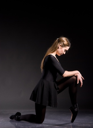 ballerina tights: Ballerina in a black skirt and a bathing suit, pointe, dance poses