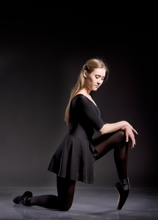 leotard: Ballerina in a black skirt and a bathing suit, pointe, dance poses