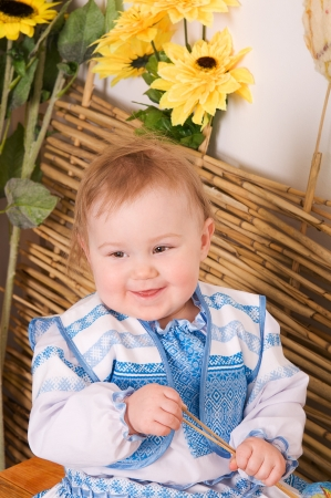 Little Girl in the Ukrainian national costume smiling photo