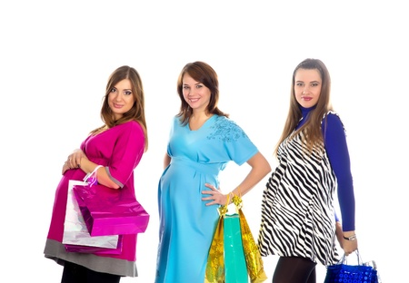 group of pregnant women in pink, blue and zebra color dresses, with shopping bags on white background