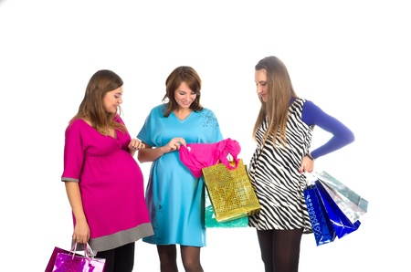 group of pregnant women in pink, blue and zebra color dresses, with shopping bags on white background photo