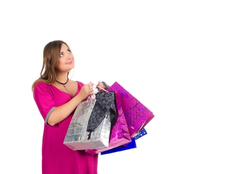 beautiful pregnant woman with shopping bags, on white background photo
