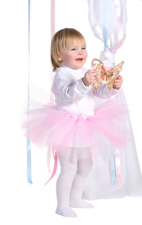 Happy laughing young girl in a pink tutu with butterfly photo