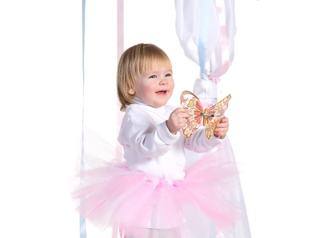 happy laughing little girl in a tutu and butterfly in his hands photo