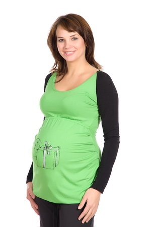 beautiful pregnant woman in a fashionable green jumper with a pattern on the abdomen, on a white background