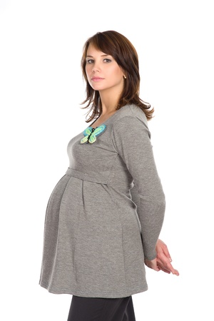 beautiful pregnant woman in a gray jumper, white background